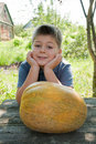 Boy with a big melon Royalty Free Stock Photo