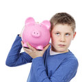 Boy with big pink piggy bank Royalty Free Stock Photo