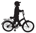 Boy on bike goes for a walk with the Royalty Free Stock Images