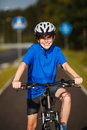 Boy biking on cycle lane Stock Image