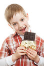 Boy biting bar of chocolate Royalty Free Stock Photo
