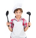 Boy with black spoons Stock Photo