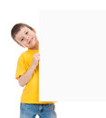 Boy with blank paper sheet isolated Stock Photo