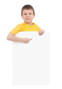 Boy with blank paper sheet on white Stock Image