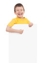 Boy with blank paper sheet on white Stock Images