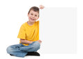 Boy with blank paper sheet on white Royalty Free Stock Photography