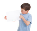 Boy with blank sheet paper isolated Royalty Free Stock Photo