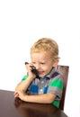 Boy blond joke laugh interlocutor while talking on the phone Royalty Free Stock Image