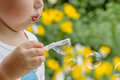 Boy blowing bubbles little in the garden Stock Images