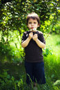 Boy blowing dandelion garden Royalty Free Stock Images