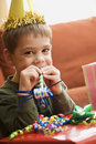 Boy blowing noisemaker. Royalty Free Stock Photography