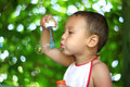 Boy blowing soap bubbles Stock Photography
