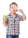 Boy blowing soap bubbles on white portrait of funny little isolated ehite background Royalty Free Stock Photography