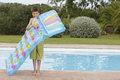 Boy blowing up air mattress against pool full length of a young the Stock Photography