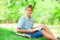Boy with books teen in the park Royalty Free Stock Images