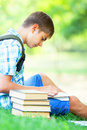 Boy with books teen in the park Royalty Free Stock Photography