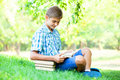 Boy with books teen in the park Royalty Free Stock Photos