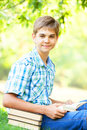 Boy with books teen in the park Stock Photography