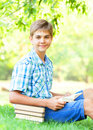Boy with books teen in the park Stock Photos