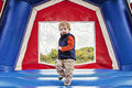 Boy in bounce house toddler jumping inside a Royalty Free Stock Images