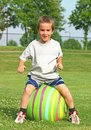 Boy Bouncing on a Ball Stock Photos