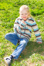 Boy with a bouquet of dandelions Royalty Free Stock Photo