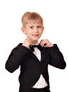 Boy with bow tie and black tuxedo Royalty Free Stock Photography