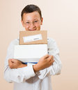 Boy with boxes of parcels in the hands Royalty Free Stock Photo