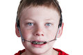 Boy with braces and headgear Royalty Free Stock Photo