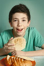 Boy with bread close up happy portrait Royalty Free Stock Photo