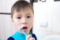 Boy brushing teeth, child dental care, oral hygiene concept, child in bathroom with tooth brush Royalty Free Stock Photo