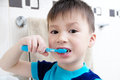 Boy brushing teeth, child dental care, oral hygiene concept, child portrait in bathroom with tooth brush
