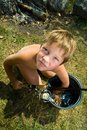 Boy with a bucket and a fishing rod Stock Photo