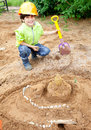 Boy builder in a protective helmet Royalty Free Stock Photo
