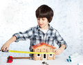 Boy builder tape measure home Royalty Free Stock Photos
