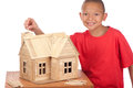 Boy builds popsicle house Stock Images