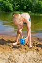 Boy builds a sand Royalty Free Stock Photo