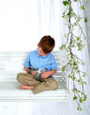 Boy and Bunny on Swing Royalty Free Stock Photo