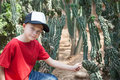 Boy among cacti in the botanical park of Stock Images