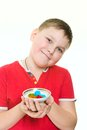 Boy with candies on a white background Royalty Free Stock Photography