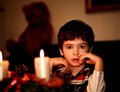Boy  with candle. New year. Christmas Royalty Free Stock Photos