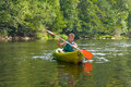 Boy canoeing on river Stock Images