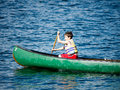 Boy Canoeing at Summer Camp Stock Photography