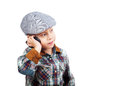 Boy in a cap on the phone Royalty Free Stock Images