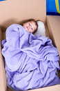 Boy in cardboard box little is lying a and revealed to be Royalty Free Stock Photography
