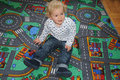Boy on carpet Royalty Free Stock Photo