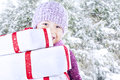 Boy carry christmas gifts on snow background Stock Images