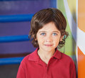 Boy in casuals smiling in preschool portrait of little Stock Photography
