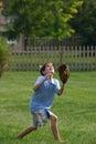 Boy Catching Ball Stock Photo