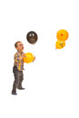 Boy catching balloons Royalty Free Stock Photo